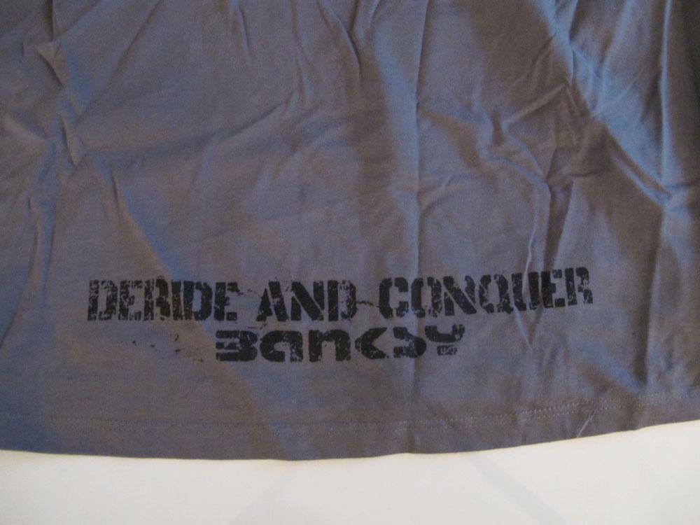 http://hankpank.net/banksy/misc/clothes-deride-conquer2.jpg